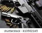 handgun with rifle over dark... | Shutterstock . vector #613502165