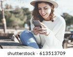 cheerful female traveler...   Shutterstock . vector #613513709