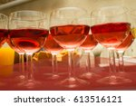 glasses of wine on the table | Shutterstock . vector #613516121