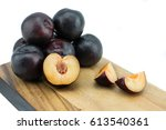 ripe tasty plums on the wooden... | Shutterstock . vector #613540361