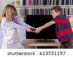 siblings fighting desperately... | Shutterstock . vector #613551197