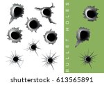 vector set of bullet holes in... | Shutterstock .eps vector #613565891