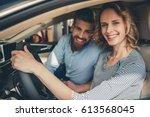 visiting car dealership.... | Shutterstock . vector #613568045