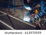 industrial welder with torch... | Shutterstock . vector #613570559
