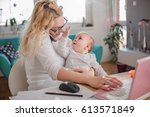 mother holding baby  talking on ... | Shutterstock . vector #613571849