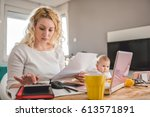 mother holding letter and using ... | Shutterstock . vector #613571891