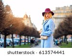young beautiful girl in a blue... | Shutterstock . vector #613574441