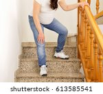 pregnant woman walking down the ...   Shutterstock . vector #613585541