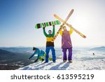 happy skier and snowboarder... | Shutterstock . vector #613595219