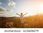 children raise their arms up to ... | Shutterstock . vector #613606079