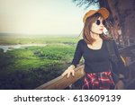 tourist young woman wearing hat ... | Shutterstock . vector #613609139