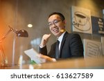 happy asian man using tablet | Shutterstock . vector #613627589