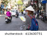 young traveler with backpack... | Shutterstock . vector #613630751