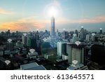 wifi icon and bangkok city with ... | Shutterstock . vector #613645571