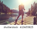hiking man in canadian... | Shutterstock . vector #613655825