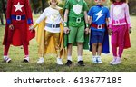 kids wear superhero costume... | Shutterstock . vector #613677185