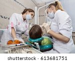 the dentist and nurse treated... | Shutterstock . vector #613681751