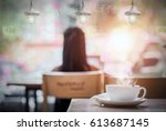 white cup of hot coffee on the... | Shutterstock . vector #613687145