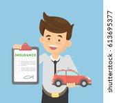man shows car insurance. happy... | Shutterstock .eps vector #613695377