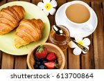 cup of coffee and croissants on ... | Shutterstock . vector #613700864