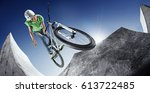 extrem sport. boy jumping with... | Shutterstock . vector #613722485