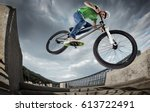 extrem sport. boy jumping with... | Shutterstock . vector #613722491
