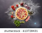 whole italian pizza on wood... | Shutterstock . vector #613728431