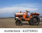 tractor at the beach  the sea... | Shutterstock . vector #613733021