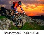 cyclist riding the mountain... | Shutterstock . vector #613734131