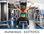 young woman training in a gym | Shutterstock . vector #613752521