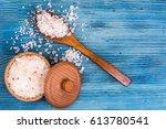 large pink sea salt on blue...   Shutterstock . vector #613780541