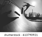 skater doing kickflip on the... | Shutterstock . vector #613790921