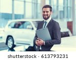 businessman with clipboard... | Shutterstock . vector #613793231