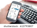 hand holding a smartphone... | Shutterstock . vector #613793807