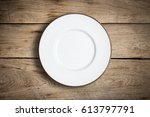 top view of blank white dish on ... | Shutterstock . vector #613797791