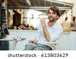 handsome and relaxed man... | Shutterstock . vector #613803629