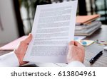 checking a document in office | Shutterstock . vector #613804961