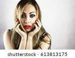 girl with bright makeup | Shutterstock . vector #613813175