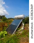 Small photo of The big screen of solar battery placed in the garden. agrarian equipment. Vertical outdoors shot.