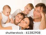 young couple and their sons on... | Shutterstock . vector #61382908