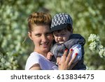 little baby boy with her young... | Shutterstock . vector #613834475