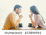 young couple in cafe | Shutterstock . vector #613846961