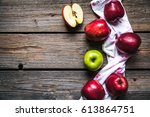 red apples and a kitchen towel... | Shutterstock . vector #613864751