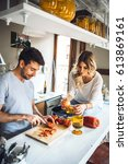 young content couple cooking... | Shutterstock . vector #613869161