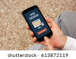 hands holding smart phone with...