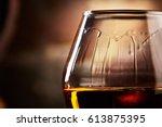 glass with cognac closeup   Shutterstock . vector #613875395
