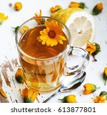 glass cup of herbal tea and... | Shutterstock . vector #613877801