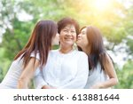 portrait of asian daughters... | Shutterstock . vector #613881644