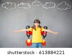 kid with jet pack. child... | Shutterstock . vector #613884221