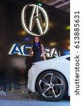 Small photo of MOSCOW, RUSSIA - SEPTEMBER 2, 2014: Moscow international automobile salon. Girl near Acura car.